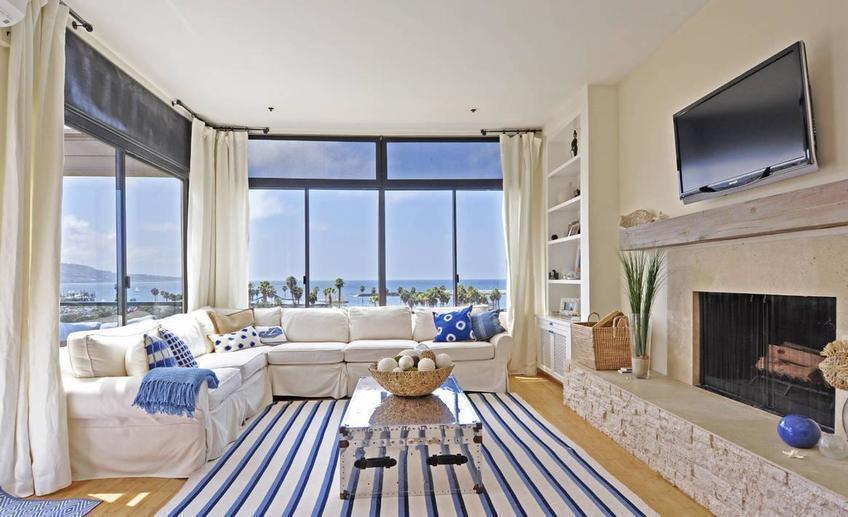 Stylish nautical living room interior decor with cool white and blue striped rug