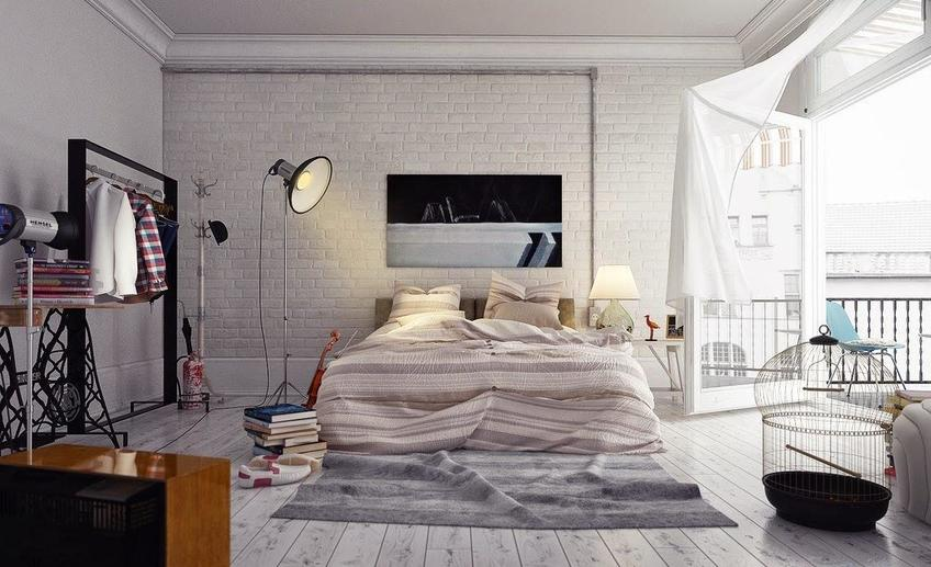 6 the awesome gorgeous loft style bedroom has a floor standing lamp hardwood flooring brick wall a clothes hanger rack a striped bed linen pile of books and a bird cage