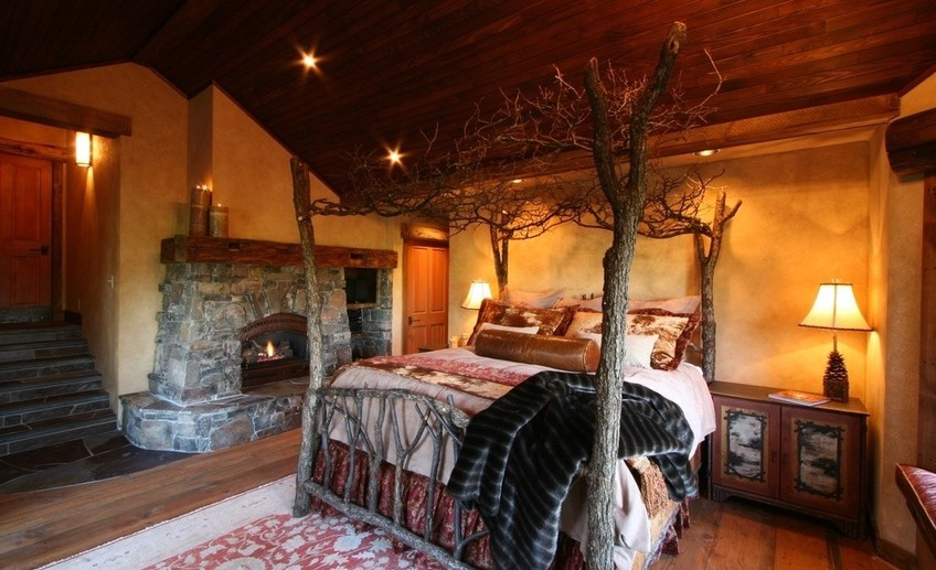 Rustic master bedroom with stone fireplace i g is1zvahzqwg6h50000000000 p1dcu