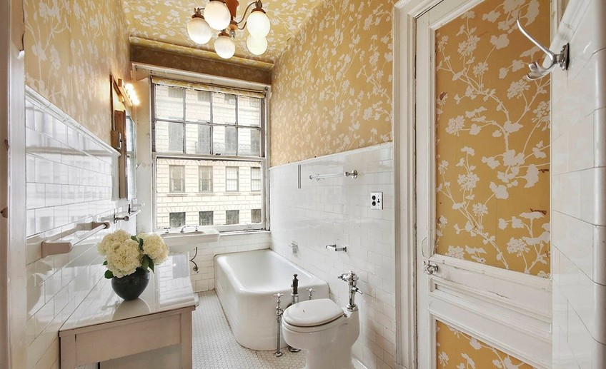 Traditional full bathroom with wallpaper and penny tile i g isdovg59tjcbxu1000000000 zv4si