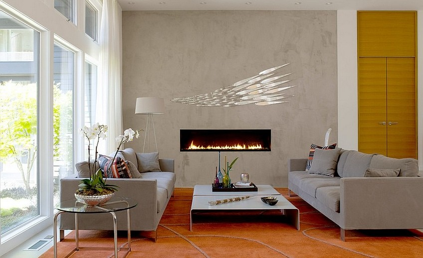 Usual sleek contemporary fireplace and concerete wall become the focal point in the room