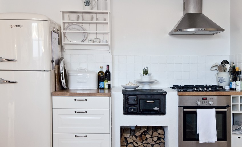Usual wood burning kitchen scandinavian kitchen with small wood burning stove